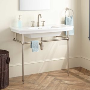 However, Instead Of One Pedestal, The Sinks Sits On Four Legs, Like A Table.